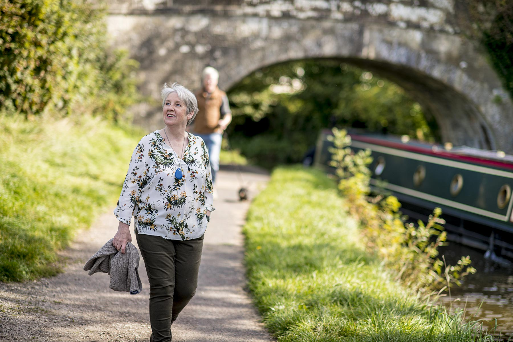 Independent lady by canal using Chiptech GO Mobile Personal Safety Device